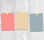 Colored hanging adhesive paper notes on the boards. Royalty Free Stock Images