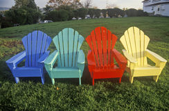 Colored Adirondack Chairs. Colorful Adirondack deck chairs on a lawn at Celtic Lodge, New England Stock Images