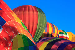 Colored air balloons at the blue sky Royalty Free Stock Photos
