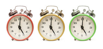 Colored alarm clocks isolated Stock Photo