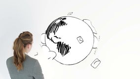 Colored animation showing envelopes circling the earth and a businesswoman Stock Photography