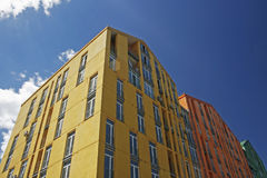 Colored apartment buildings Stock Images
