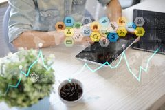 Colored applications icons and graphs on virtual screen. Business, internet and technology concept. Colored applications icons and graphs on virtual screen Royalty Free Stock Images