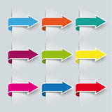 9 Colored Arrow Banners. 9 colored arrows on the grey background Royalty Free Stock Photos