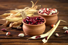 Colored assorted french beans in wooden bowls Royalty Free Stock Image
