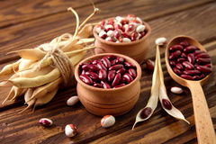 Colored assorted french beans in wooden bowls Stock Photo