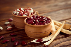 Colored assorted french beans in wooden bowls Stock Images
