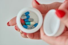 Colored assorted pharmaceutical medicine pills, tablets and capsules. royalty free stock image