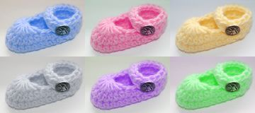 Colored baby booties Stock Image
