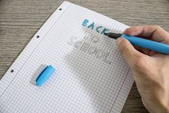 Colored back to school handwritten on a paper. Composition royalty free stock images