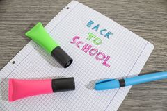 Colored back to school handwritten on a paper. Composition stock images