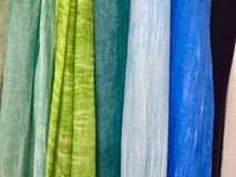 Colored background. hanging scarves of various colors. Background check free stock images