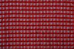 Texture of a piece of cloth red white. Colored background of a piece of cloth Stock Photography