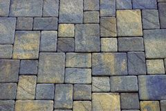 Colored background of stone paving tiles on the road Stock Photos