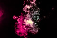 Colored background with winding clouds of smoke from patterns of different forms of pink, green and blue colors with tongues of stock photo