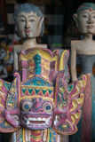 Colored Balinese wooden statues in tourist market in Ubud. Indon Stock Photos