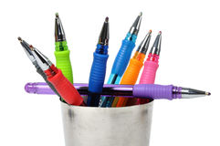 Colored ball-pen in steel cup Stock Photo