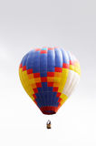Colored balloon over grey sky Royalty Free Stock Image