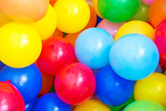Colored Balloons. Balloons of many colours in a large pile stock photos