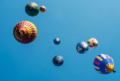 Colored balloons on a blue background Royalty Free Stock Photography