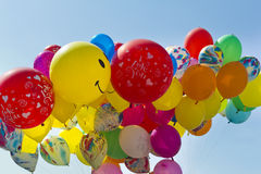 Colored Balloons on blue sky Stock Images
