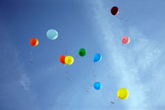 Colored balloons flying in the blue sky. The colored balloons flying in the blue sky royalty free stock photo