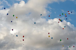 Colored balloons flying in the sky Stock Photo