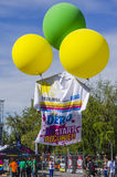 Colored balloons lifting giant T-shirt Royalty Free Stock Photo