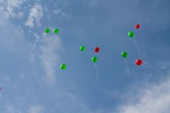 Colored balloons on sky. Red and green balloons in the sky Stock Photos
