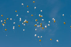Colored balloons in sky Stock Images