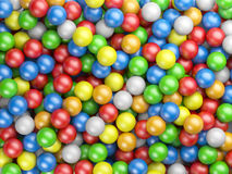 Colored balls background. From small spheres Stock Photography