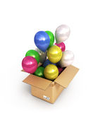 Colored balls in a cardboard box for deliveries  on whit Stock Photos