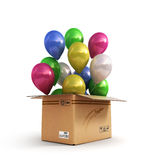 Colored balls in a cardboard box for deliveries  on whit Royalty Free Stock Image