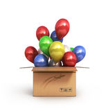 Colored balls in a cardboard box for deliveries  on whit Stock Images