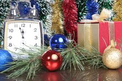 Colored balls , clock and gift boxes on christmas background. Stock Photography