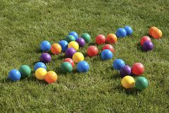 Colored balls. On green grass background Royalty Free Stock Photo