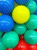 Colored  balls in grid. Studio Photo Stock Photos