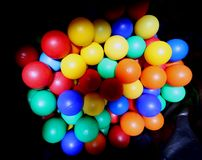 Colored balls inside the big bag black Royalty Free Stock Photo