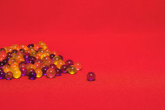 Colored balls. The little colored balls on a pink background Royalty Free Stock Photography
