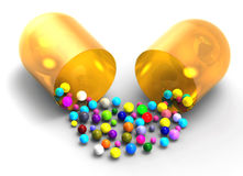 Colored balls spilling from the open capsule Royalty Free Stock Photos