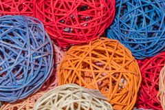Colored balls of straw. Decorative spheres made of straw and painted in different bright colors stock photos
