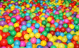 Colored balls to play 5. Colorful plastic balls in which children can jump, swim and play Stock Photo