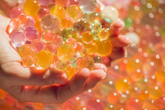 Colored balls of water beads, hydrogel in in hands. Sensory expe. Riences Royalty Free Stock Image