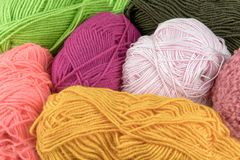 Colored balls of yarn. Knit yarn for knitting. Skeins of fabric.  Royalty Free Stock Photo