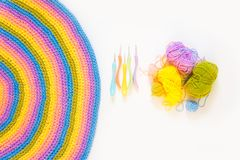 Color striped crocheted crochets. White background. Colored balls of yarn. View from above. Rainbow colors. All colors. Yarn for knitting. Skeins of yarn Stock Photography