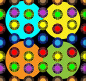 Colored balls of yellow, blue, purple and green colors on a dark background. Colored balls of various sizes on a dark background Stock Images