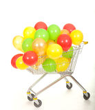 Colored baloons in shopping catr Royalty Free Stock Photo