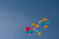 Colored baloons in the sky. The amount of colored baloons in the deep blue sky stock photography