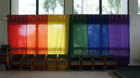 Colored banners draped over windows. Royalty Free Stock Photography