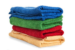 Colored bathroom towels stock images